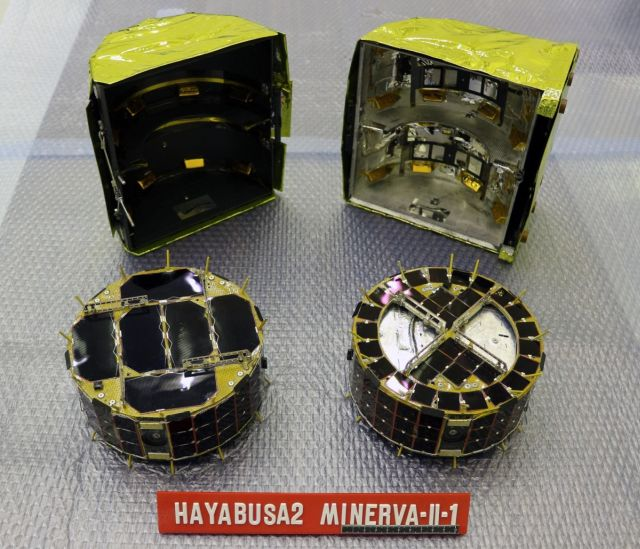 The bottom of the Hayabusa2 spacecraft. (Image credit: JAXA) The small rovers, MINERVA-II1. Rover-1A is on the left and Rover-1B is on the right. Behind the rovers is the cover in which they are stored. (Image credit: JAXA).
