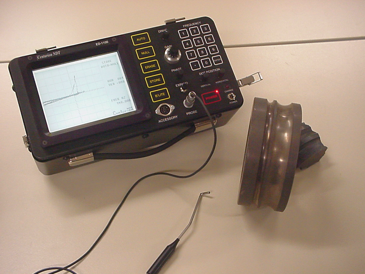 In aircraft maintenance and repair, eddy current devices have long been used to nondestructively test (NDT) wheels, struts, propellers, airframes, hubs, engine components, and other parts for flaws, such as cracks, fatigue, or corrosion in a variety of metals, including aluminum and steel alloys. Multiple eddy current test instruments are traditionally used to address the full scope of work, which can involve inspecting surfaces, welds, tubing, and bolt holes.